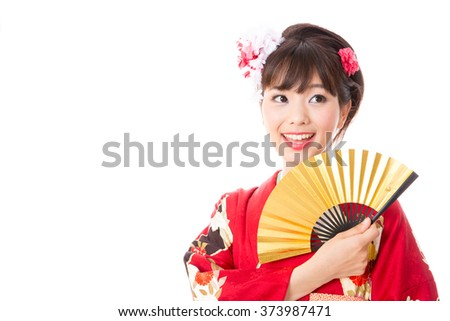 portrait of attractive asian woman wearing kimono isolated on white background