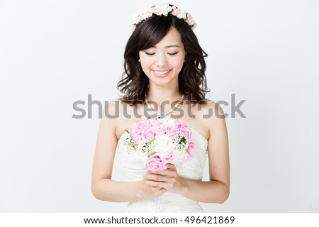 portrait of attractive asian woman wearing wedding dress isolated on white background