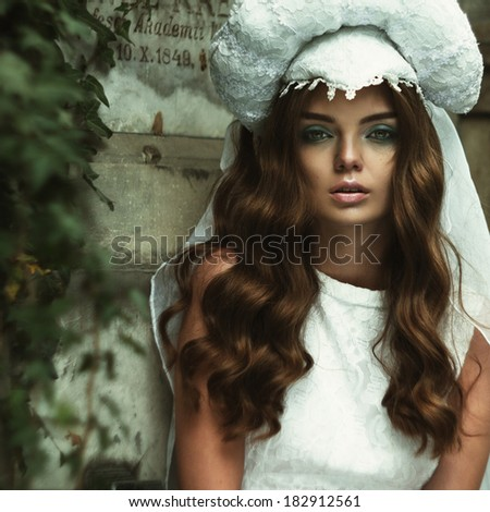 Portrait of attractive beautiful blonde woman in retro style grain and texturer added - stock photo