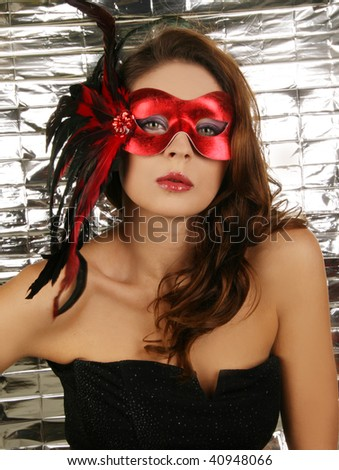 Portrait of attractive beautiful woman carnival mask.
