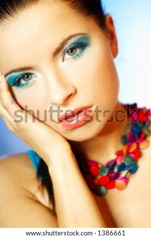 Portrait of attractive beautiful young sexy woman with blue makeup