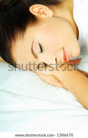 Portrait of attractive beautiful young woman on bed