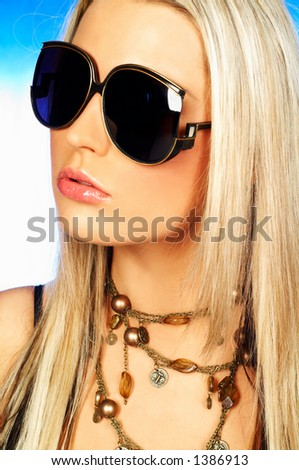 Portrait of attractive beautiful young woman wearing sunglasses