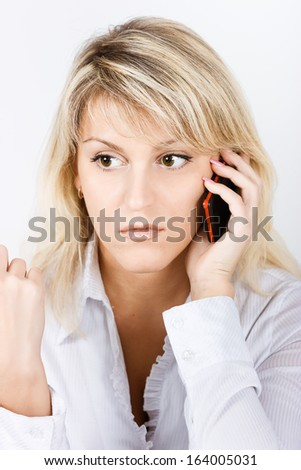 Portrait of attractive blond girl with a mobile phone - stock photo