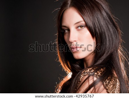 Portrait of attractive brunette sexy girl over gray - stock photo