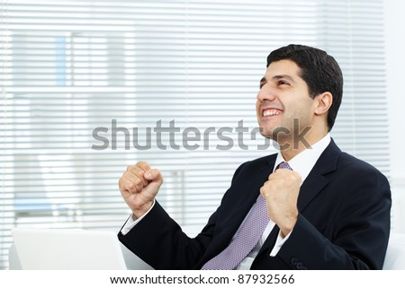 Portrait of attractive businessman expressing his triumph - stock photo