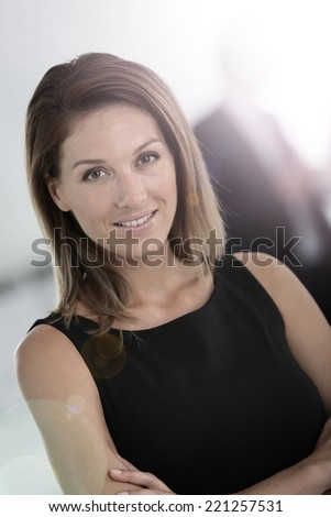 Portrait of attractive businesswoman, people in background - stock photo