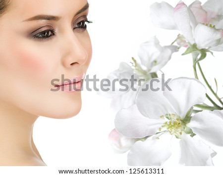 portrait of attractive  caucasian  face woman brunette isolated on white studio shot flowers - stock photo