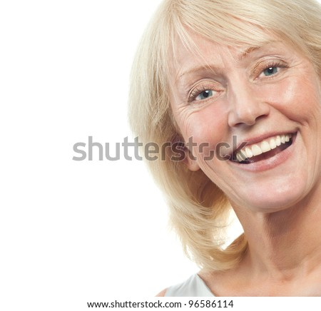 portrait of attractive  caucasian smiling mature woman blond isolated on white studio shot - stock photo