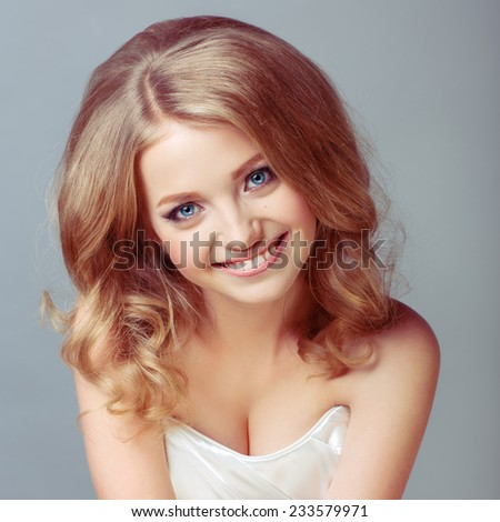 portrait of attractive caucasian smiling woman blond isolated - stock photo