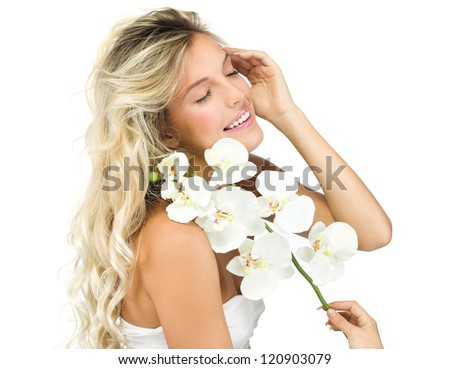 portrait of attractive  caucasian smiling woman blond isolated on white studio shot flower orchids toothy smile face long hair head and shoulders looking at camera - stock photo