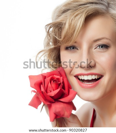 portrait of attractive  caucasian smiling woman blond isolated on white studio shot in red dress with rose - stock photo