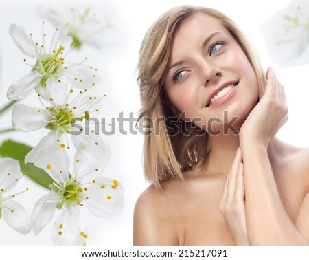 portrait of attractive  caucasian smiling woman blond isolated on white studio shot  lips toothy smile face hair head and shoulders closeup hands flowers aroma spring - stock photo