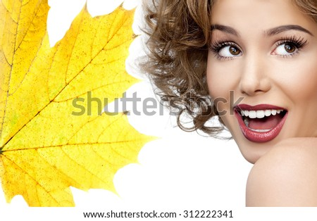 portrait of attractive  caucasian smiling woman blond isolated on white studio shot red  lips toothy smile face head and shoulders yellow maple leaf - stock photo