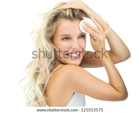 portrait of attractive  caucasian smiling woman blond isolated on white studio shot  toothy smile face long hair head and shoulders cleaning her face - stock photo