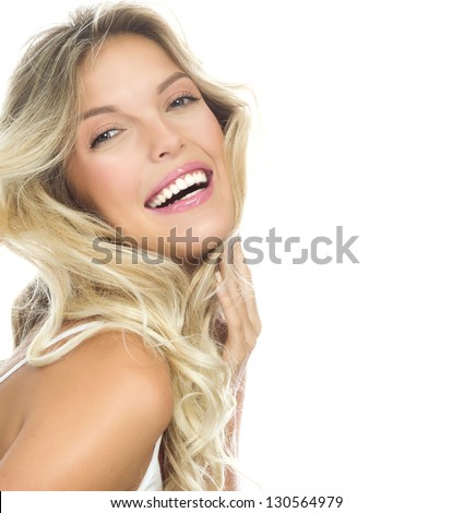 portrait of attractive  caucasian smiling woman blond isolated on white studio shot  toothy smile face long hair head and shoulders looking at camera - stock photo
