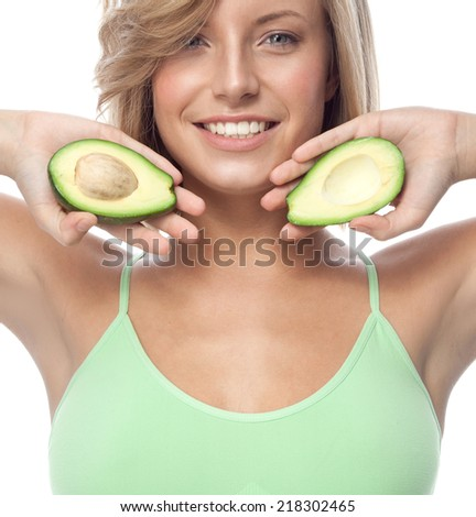 portrait of attractive  caucasian smiling woman isolated on white studio shot eating avocado - stock photo