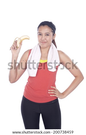 portrait of attractive caucasian smiling woman isolated on white studio shot eating banana
