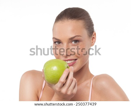 portrait of attractive  caucasian smiling woman isolated on white studio shot eating green apple - stock photo