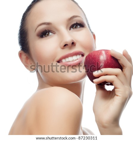portrait of attractive  caucasian smiling woman isolated on white studio shot eating red apple