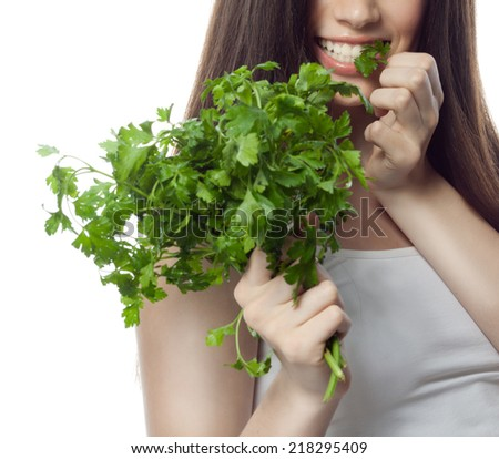 portrait of attractive  caucasian smiling woman isolated on white studio shot eating salat - stock photo