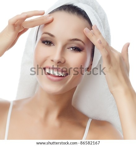 portrait of attractive  caucasian smiling woman isolated on white studio shot head in towel looking at camera - stock photo