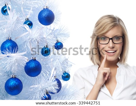 portrait of attractive  caucasian smiling woman isolated on white studio shot looking at camera wearing glasses new year christmas tree blue balls - stock photo
