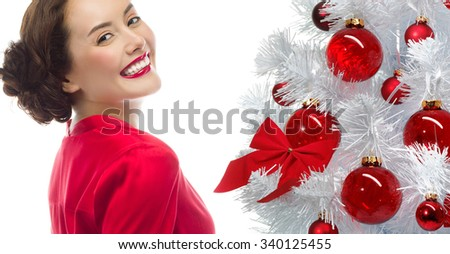 portrait of attractive  caucasian smiling woman isolated on white studio shot looking at camera christmas new year tree - stock photo