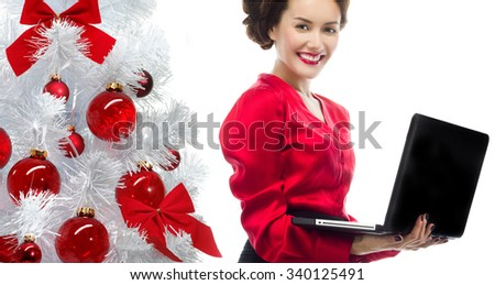 portrait of attractive  caucasian smiling woman isolated on white studio shot looking at camera christmas new year tree notebook computer - stock photo