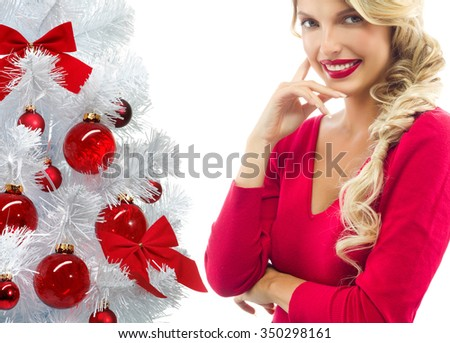 portrait of attractive  caucasian smiling woman isolated on white studio shot looking at camera christmas tree red balls - stock photo
