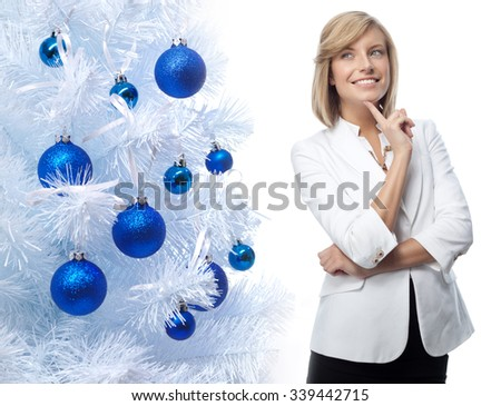 portrait of attractive  caucasian smiling woman isolated on white studio shot new year christmas tree blue balls - stock photo