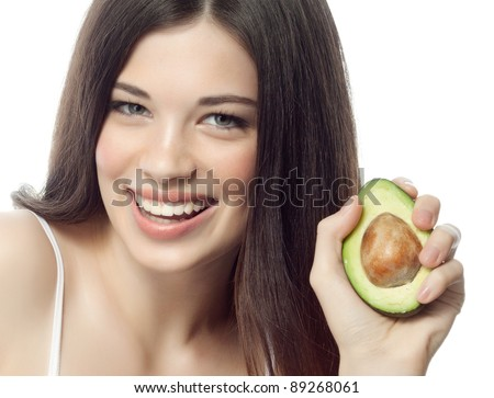 portrait of attractive  caucasian smiling woman isolated on white studio shot with avocado - stock photo