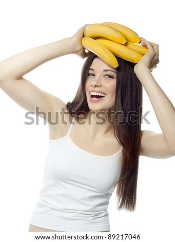 portrait of attractive  caucasian smiling woman isolated on white studio shot with bananas - stock photo