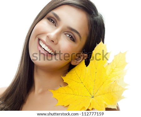 portrait of attractive  caucasian smiling woman isolated on white studio shot with maple autumn leaf - stock photo