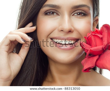 portrait of attractive  caucasian smiling woman isolated on white studio shot with red rose looking at camera - stock photo