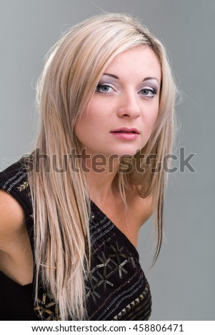 portrait of attractive caucasian smiling woman on gray background, studio shot - stock photo