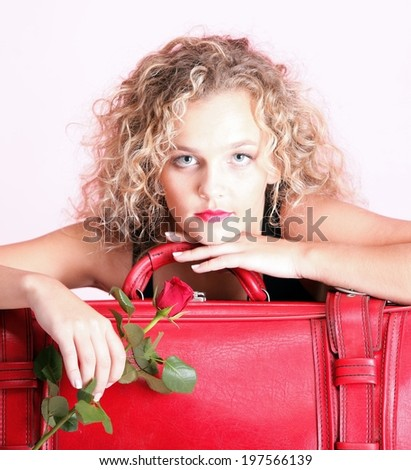 portrait of attractive caucasian woman blond wait red rose - stock photo