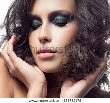 portrait of attractive  caucasian  woman brunette hair isolated on white studio shot   face makeup skin hands eyes - stock photo