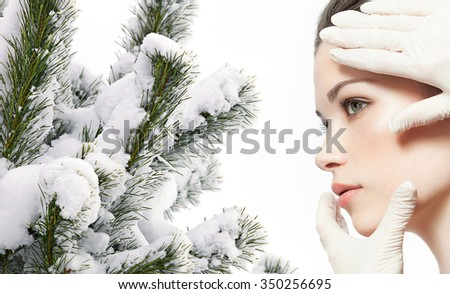 portrait of attractive  caucasian  woman brunette isolated on white studio shot christmas tree covered with snow - stock photo