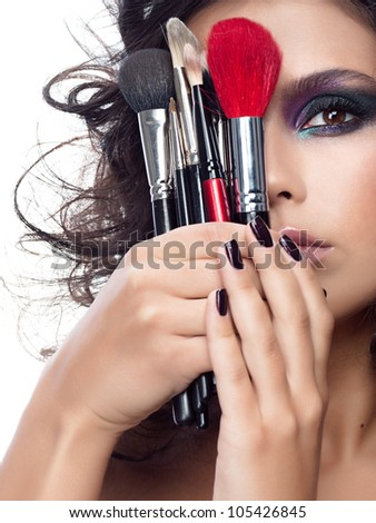 portrait of attractive  caucasian woman brunette isolated on white studio shot closeup face makeup skin eyes lips hands nails brushes - stock photo