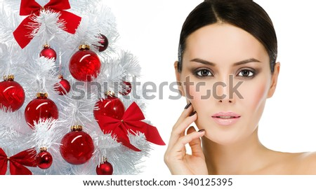 portrait of attractive  caucasian  woman brunette isolated on white studio shot face closeup skin eyes looking at camera christmas new year tree - stock photo