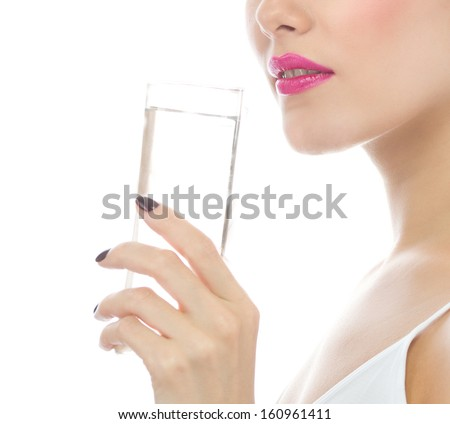 portrait of attractive  caucasian woman isolated on white studio shot drinking water - stock photo