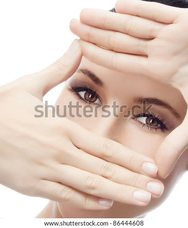portrait of attractive  caucasian  woman isolated on white studio shot with hands near the face - stock photo