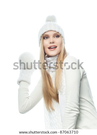 portrait of attractive  caucasian woman  with long blond hair in warm clothing isolated on white studio shot with snowball - stock photo