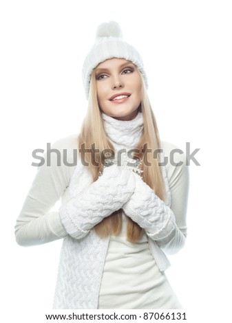 portrait of attractive  caucasian woman  with long blond hair in warm clothing isolated on white studio shot - stock photo