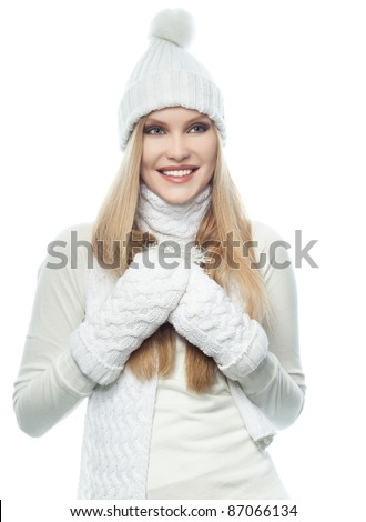 portrait of attractive  caucasian woman  with long blond hair th warm clothing isolated on white studio shot - stock photo