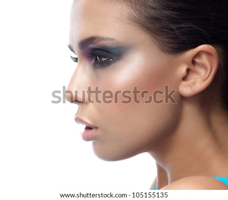 portrait of attractive  caucasian young  woman brunette isolated on white studio shot face closeup skin makeup eyes profile sideview - stock photo