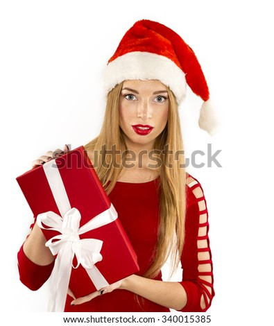 Portrait of attractive cheerful woman holding gift box with