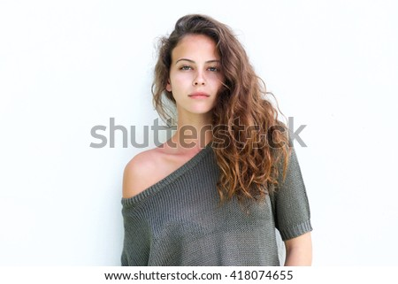 Portrait of attractive confident woman standing against white background - stock photo