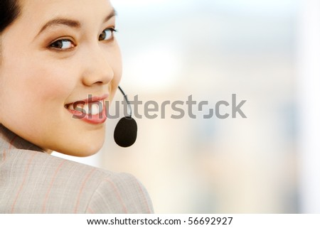 Portrait of attractive customer support representative looking at camera